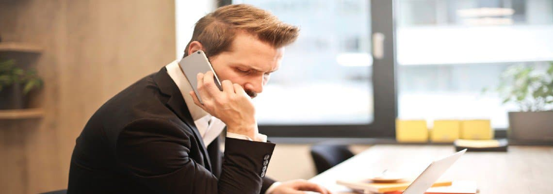man-having-a-phone-call-in-front